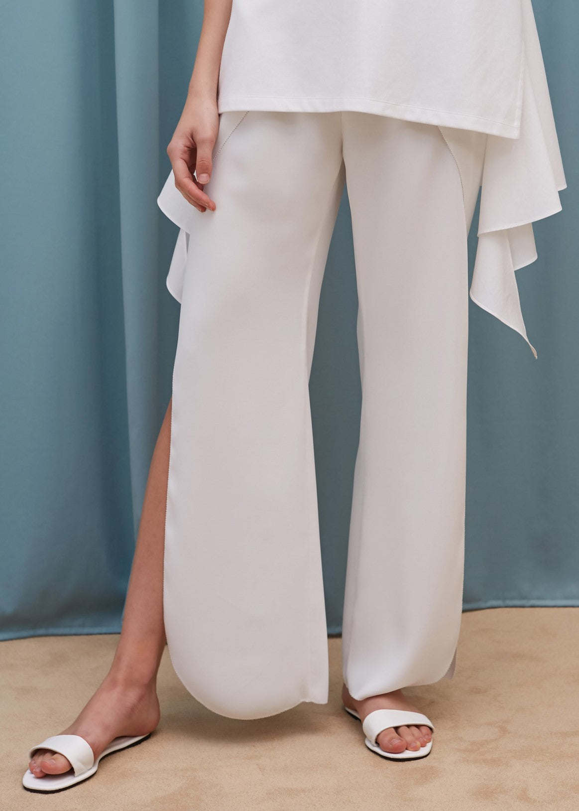 Goen.J slit flared pants in ivory