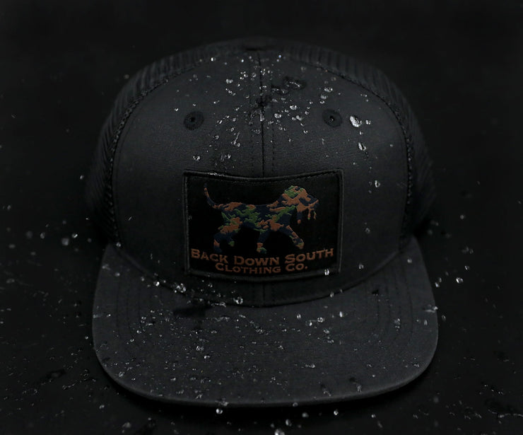 Pursuit Trucker- Black Waxed Camo Logo