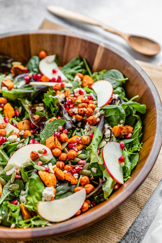 Bowl of salad with chickpeas on top