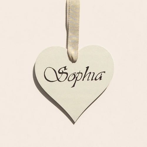 Personalized name painted on to a birch-wood heart