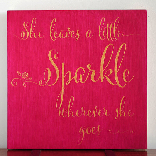 Hand painted in gold and magenta with the words She Leaves a little Sparkle Where Ever She Goes suitable for all ages