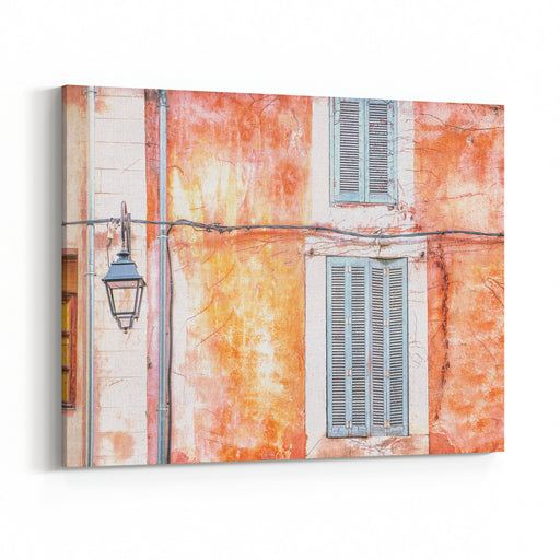 Vintage Style Photo Of The Street View Of An Old Cracked Building Wall With Peeling Paint And Grunge Textures, Closed Wooden Shutters, And An Electric Hanging Lantern Canvas Wall Art Print