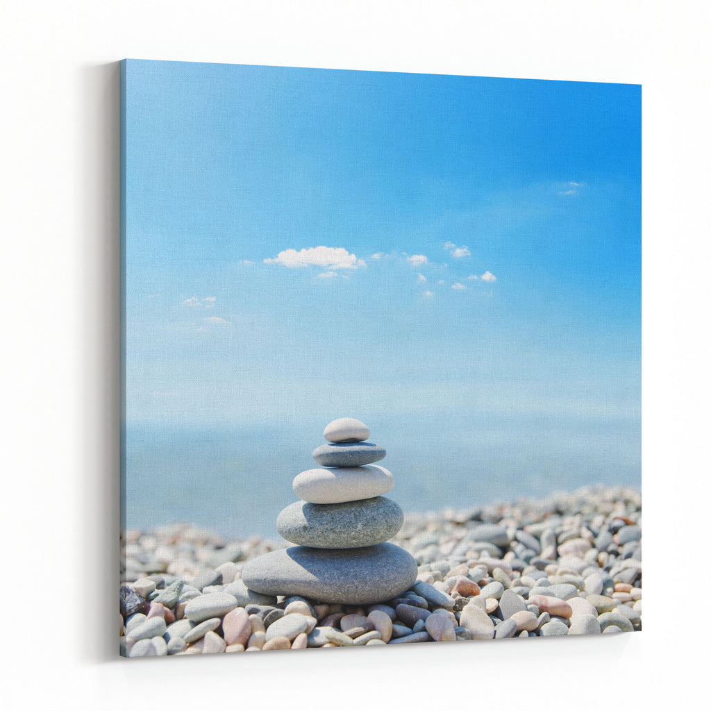 Stack Of Zen Stones Over Sea And Clouds Background Canvas Wall Art