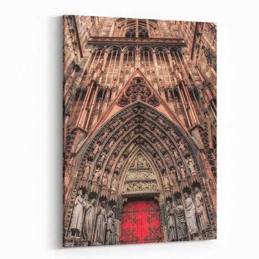 Color Outdoor Architectural Image Of A Portal Of The Cathedral Of Our Lady Of Strasbourg,France, Europe, With A Red Door Canvas Wall Art Print