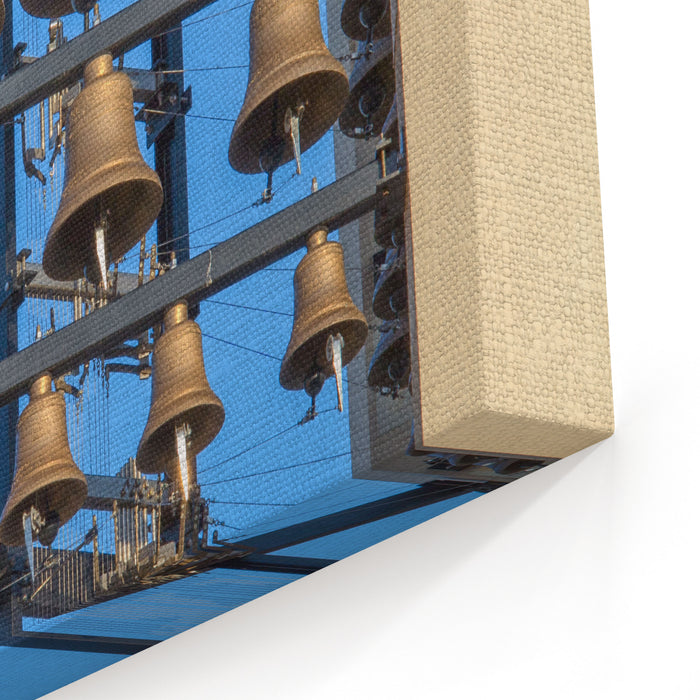 An Array Of Church Bells With Blue Sky Behind Canvas Wall Art Print