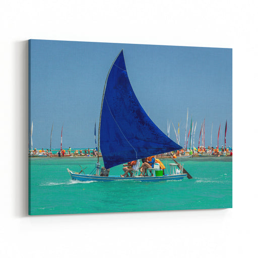 Traditional Sailing Boat Jangada Takes The Tourists On A Tour To See The Corals On The Beautiful Beach Of Pajucara, With Turquoise Blue Clear Water Maceio, Alagoas, Brazil Canvas Wall Art Print