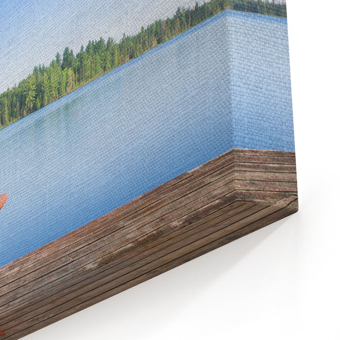 Adirondack Chair Sitting On A Wood Dock Facing A Calm Lake Across The Water There Are Green Trees Canvas Wall Art Print