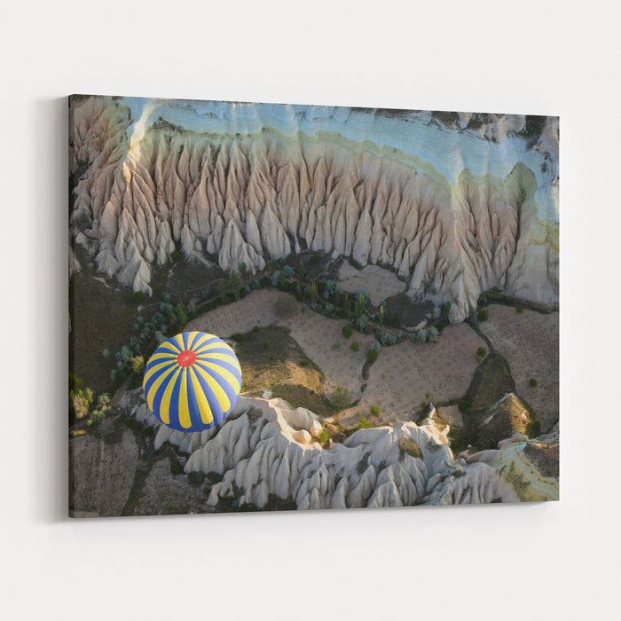 View Of The Air Balloon Flying Over Rock Formation Canvas Wall Art Print