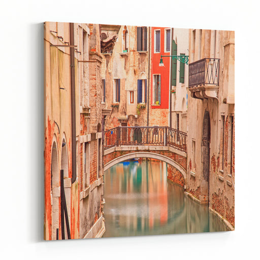 Venice, Bridge On Water Canal And Traditional Architecture In A Long Exposure Photography Canvas Wall Art Print