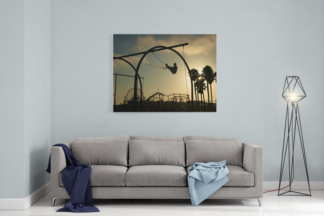 As The Sun Sets A Silhouetted Man Works Out On Gymnast Rings Canvas Wall Art Print