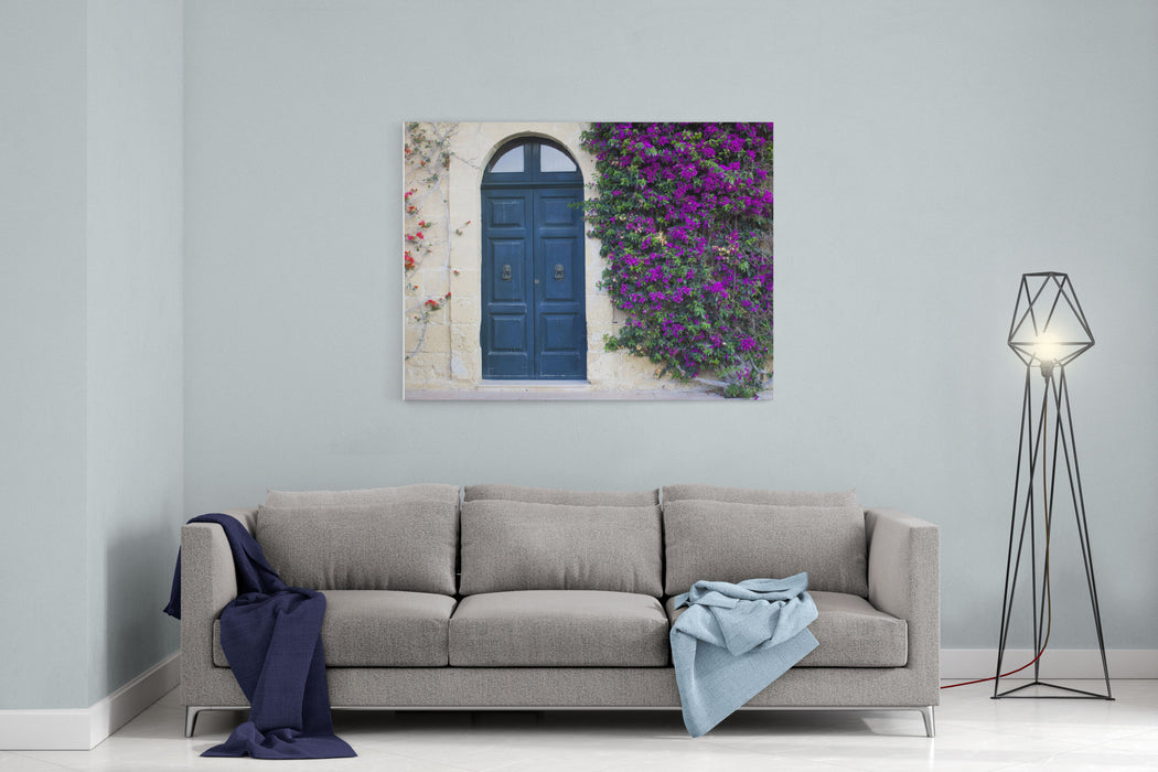 A Mediterranean House In Gozo, Malta With An Old Door And A Tree WithFlowers Climbing The Wall Canvas Wall Art Print