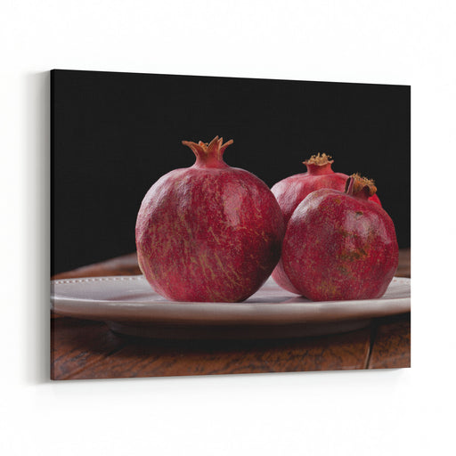 Three Freshly Picked Pomegranates With A Black Background Canvas Wall Art Print