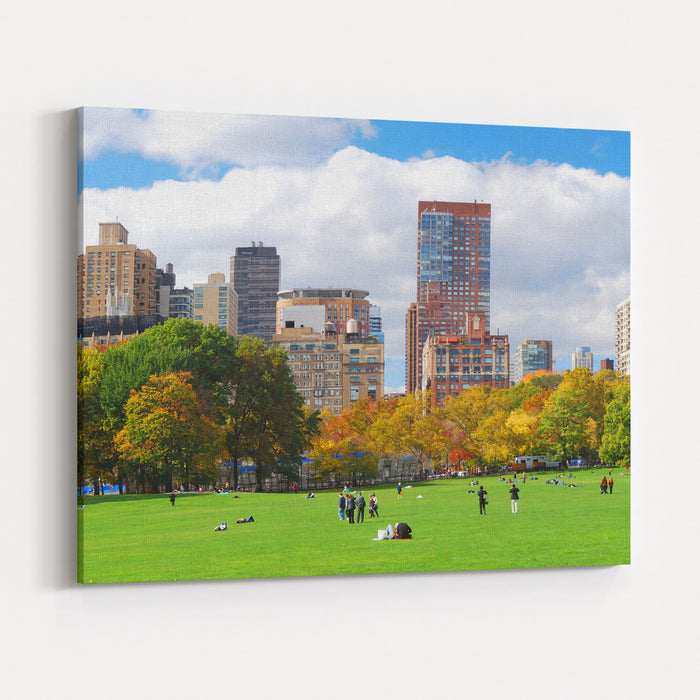 New York City Manhattan Skyline Panorama Viewed From Central Park With Cloud And Blue Sky And People In Lawn Canvas Wall Art Print