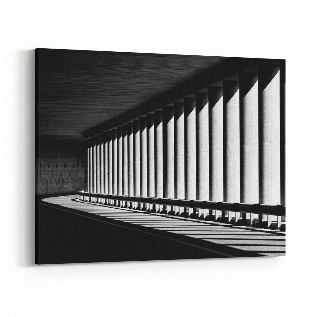 Tunnel with columns in black and white photo abstract tunnel photo black and white photo architecture details close up in black and white way road
