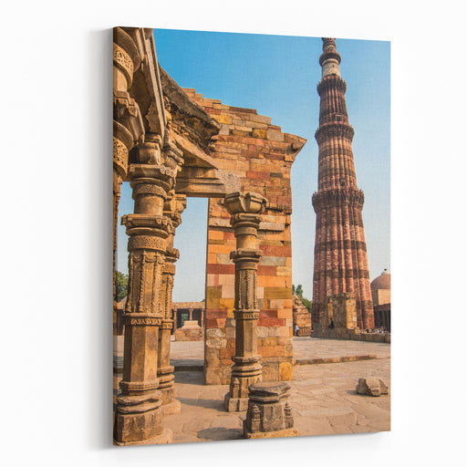 Famous Qutub Minar And Ancient Ruins In Delhi, India, UNESCO World Heritage Cite  Architecture Background Canvas Wall Art Print