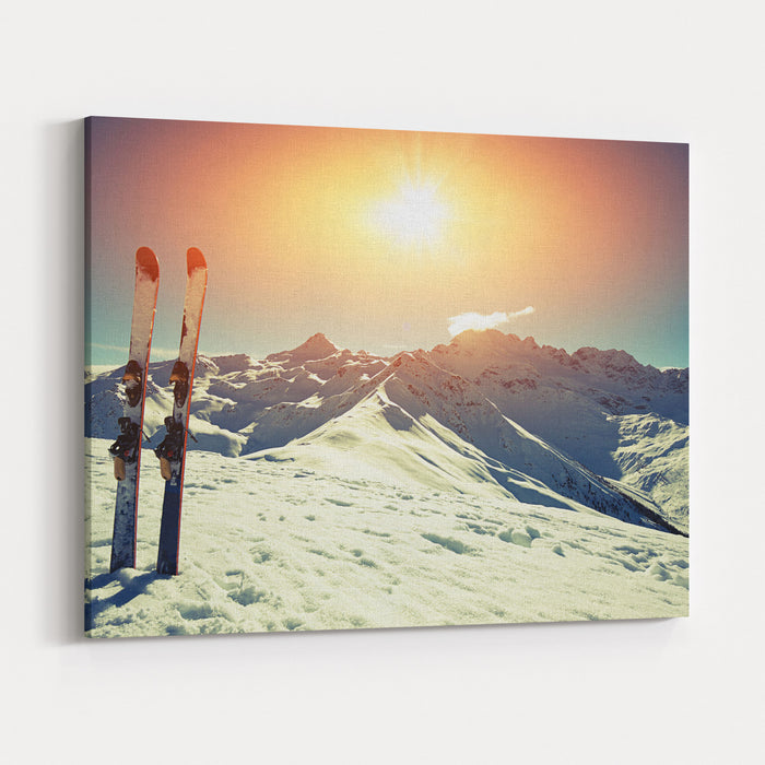 Skis In Snow At Mountains Canvas Wall Art Print
