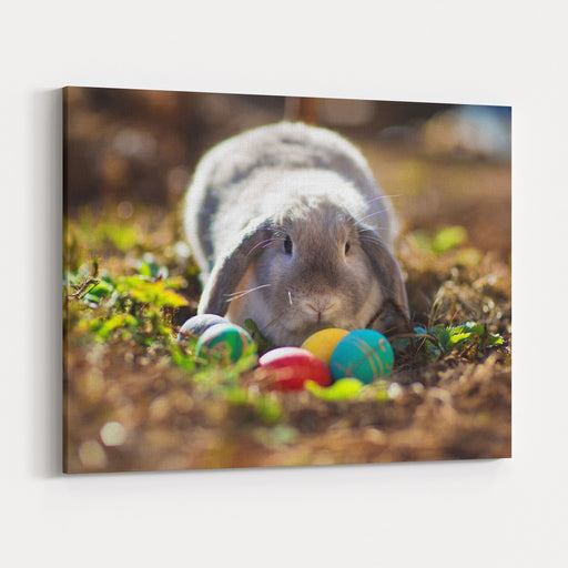 A Little Easter Rabbit Sitting Among Colored Eggs Canvas Wall Art Print
