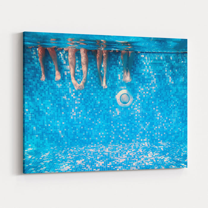 Childrens And Adults Legs Underwater In The Swimming Pool Canvas Wall Art  Print