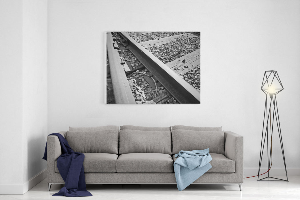 A Black And White Photo Of Train Tracks Isolated With Gravel Spreading Across The Railway Canvas Wall Art Print
