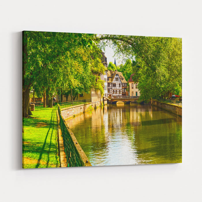 Strasbourg, Water Canal In Petite France Area Half Timbered Houses And Trees In Grand Ile Alsace, France Unesco Site Canvas Wall Art Print