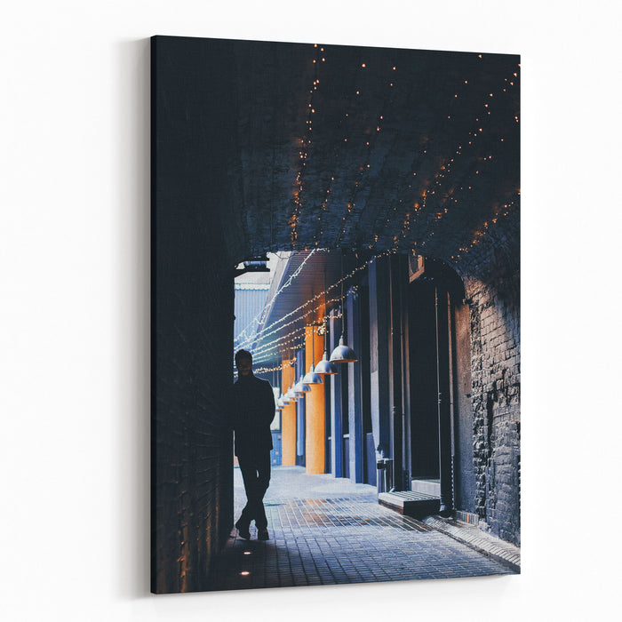 Dark Silhouette Of Man In Tunnel With Yellow Lights Canvas Wall Art Print