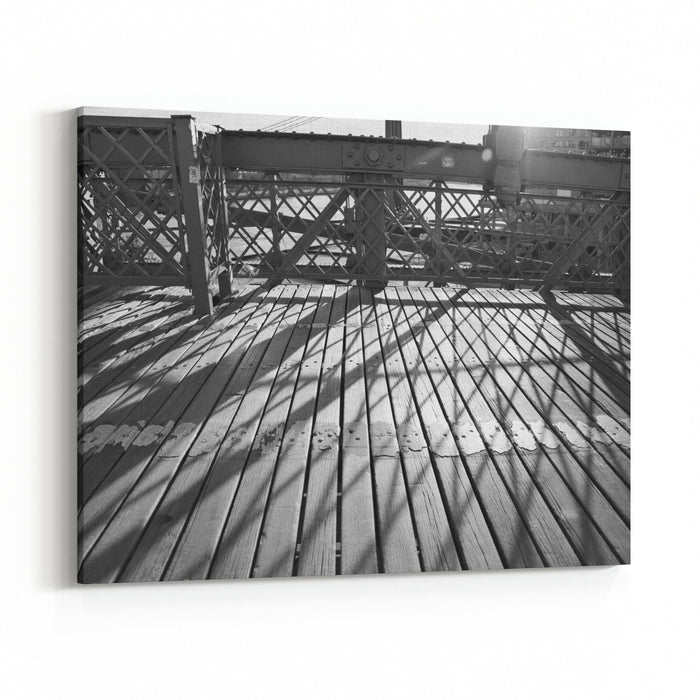 A Black And White Photograph Of Shadows And Lines Crossing The Wooden Path Of The Brooklyn Bridge In New York City Canvas Wall Art Print