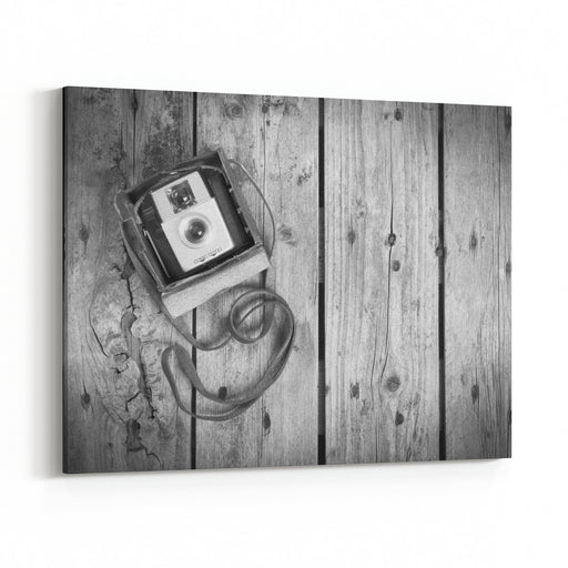 An Old Camera In Its Original Vintage Leather Case On A Wooden Background In Black And White Canvas Wall Art Print