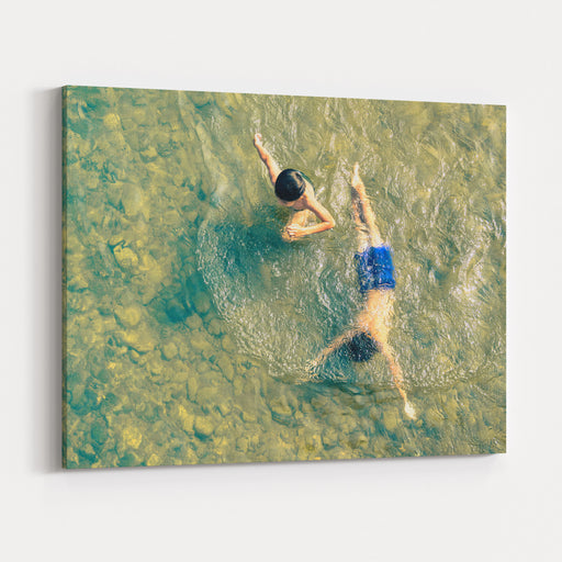 Playful Children Swimming In Nam Song River In Vang Vieng  Real Everyday Healthy Life And Fun Of Kids In Laos PDR Countryside Region  Neutral Nostalgic Color Tone With Main Focus On Boy Out Of Water Canvas Wall Art Print