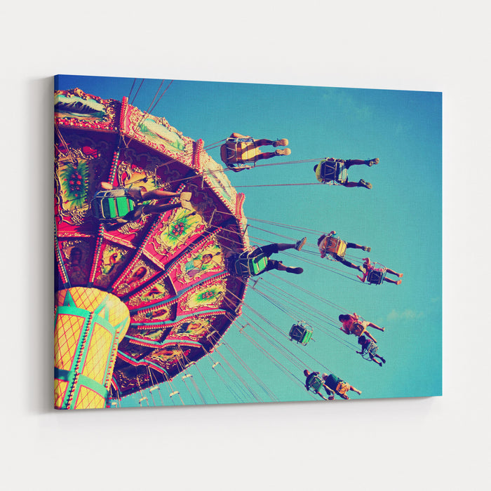 A Swinging Fair Ride At Dusk Toned With A Retro Vintage Instagram Filter App Or Action Canvas Wall Art Print