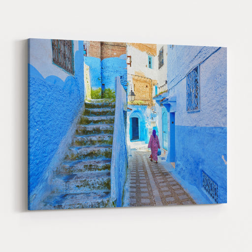 Moroccan Woman In Traditional Clothes Jellaba Walking On A Street In Medina Of Chefchaouen, Morocco, Small Town In Northwest Morocco Known For Its Blue Buildings Canvas Wall Art Print