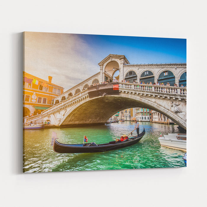 Beautiful View Of Traditional Gondola On Famous Canal Grande With Rialto Bridge At Sunset In Venice, Italy With Retro Vintage Instagram Style Filter And Lens Flare Effect Canvas Wall Art Print