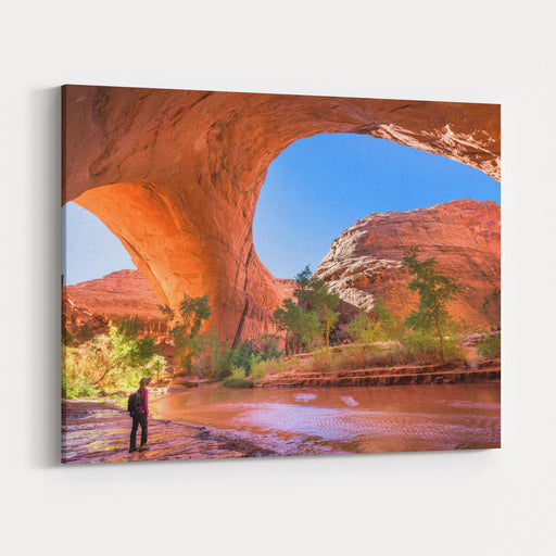A Hiker At Jacob Hamblin Arch In Coyote Gulch, Grand StaircaseEscalante National Monument, Utah, United States Canvas Wall Art Print