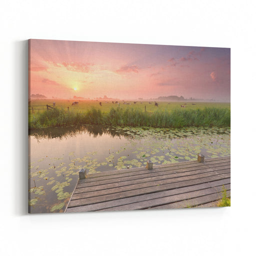 Dramatic Sunrise Over River With Pier And Cattle On Pasture, Netherlands Canvas Wall Art Print
