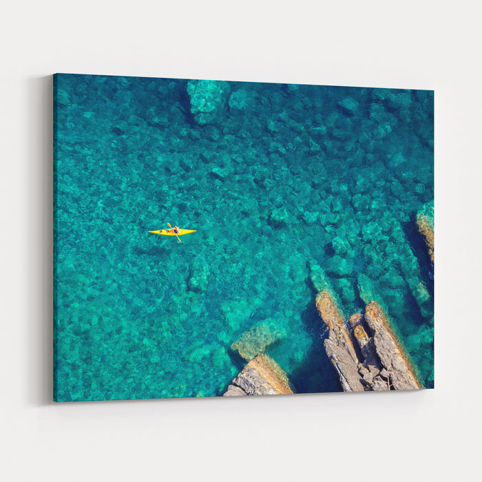 Top View Of Kayak Boat Oin Shallow Turquoise Water Of Ligurian Sea, Italy Canvas Wall Art Print