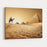 Bedouin On Camel Near Pyramids In Desert Canvas Wall Art Print