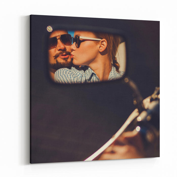 Carefree Young Couple In Sunglasses Kissing Reflected In The Mirror Of A Motorcycle Canvas Wall Art Print