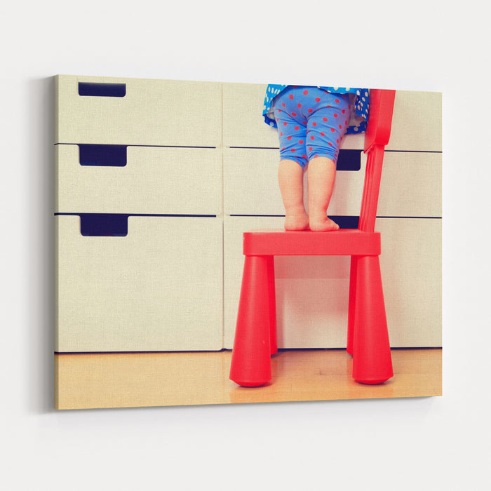 Kids Safety Concept Little Girl  Climbing On Baby Chair Canvas Wall Art Print
