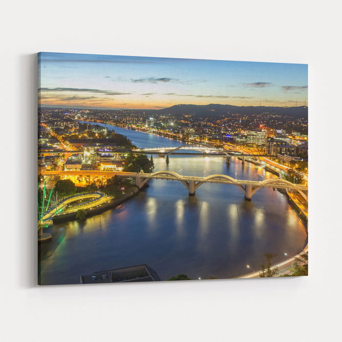 Brisbane City, Panorama Aerial Sunset View Of Kurilpa Bridge, William Jolly Bridge And Merivale Bridge Over Brisbane River With Cityscape Skyline At Twilight Dusk In Summer, Queensland, Australia Canvas Wall Art Print