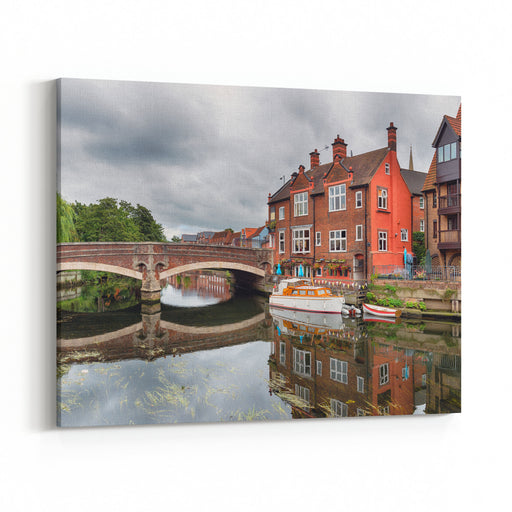 Houses And Boats On The River Yare At Norwich City Centre In Norfolk Canvas Wall Art Print