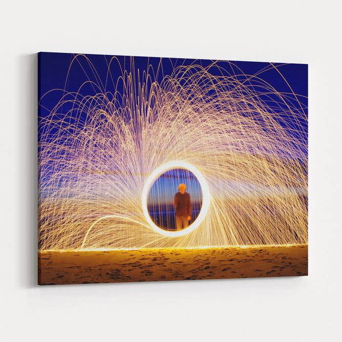 Burning Steel Wool Spinned Near The Sea Showers Of Glowing Sparks From Spinning Steel Wool Canvas Wall Art Print