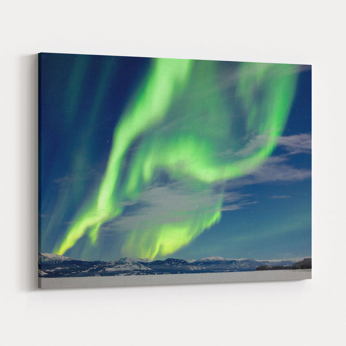 Spectacular Northern Lights Or Aurora Borealis Or Polar Lights Dancing Over Moonlit Winter Landscape Of Frozen Lake Laberge, Yukon Territory, Canada Canvas Wall Art Print