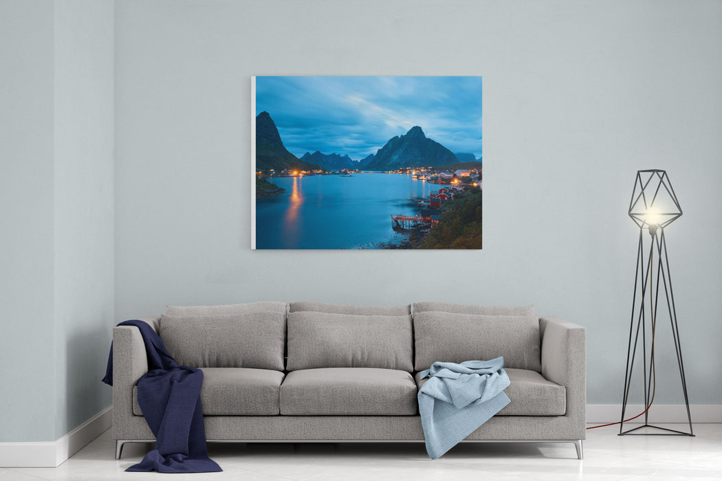Scenic Landscape On Lofoten Islands, Reine With Typical Red Fishing Hut With Grass On The Roof Near Water In The Evening Canvas Wall Art Print