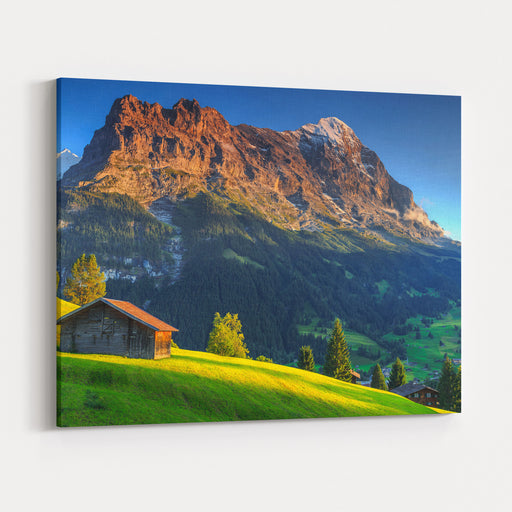 Spectacular Swiss Alpine Landscape With Green Fields And Famous Eiger Peak,Bernese Oberland,Switzerland,Europe Canvas Wall Art Print