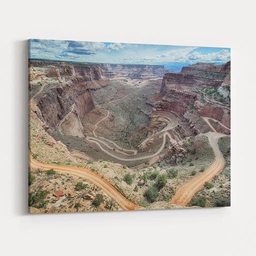 A WD Vehicle Makes Its Way Down A Dirt Road Through The Shafer Switchbacks, In The Islands In The Sky District Of Canyonlands National Park, Near Moab, Utah Canvas Wall Art Print