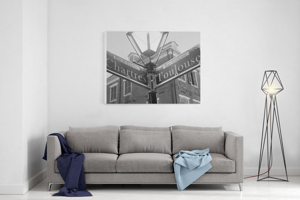 A Black And White Photo Of The Street Name Signs At The Chartres And Toulouse Streets Intersection In The French Quarter Of New Orleans Canvas Wall Art Print