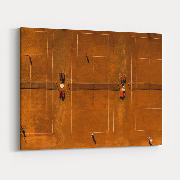 Aerial Shot Of A Tennis Courts With Players In Warm Evening Sunlight Canvas Wall Art Print