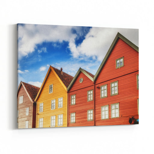 Famous Bryggen Street In Bergen Norway  Architecture Background Color Houses Builings At Blue Sky With Clouds Background And Bright Windows Mirorred Sun  Light In Sunset Time Canvas Wall Art Print