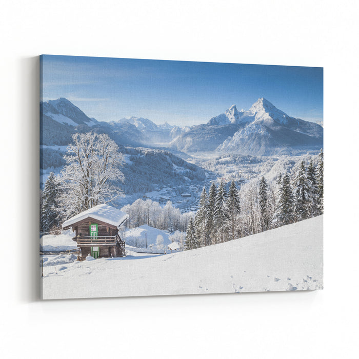 Panoramic View Of Scenic White Winter Wonderland Mountain Scenery In Thealps With Traditional Wooden Mountain Chalet On A Cold Sunny Day With Bluesky