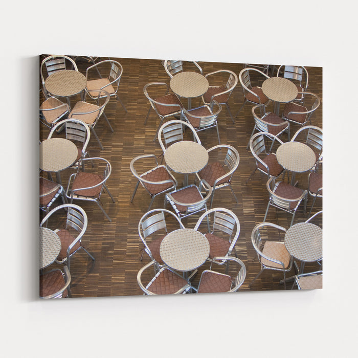 Tables And Chairs In A Restaurant Canvas Wall Art Print