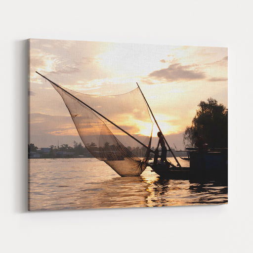 Fisherman Fishing On A Boat With Fishnet At Dusk On The Mekong River Mekong Delta, Can Tho, Vietnam Canvas Wall Art Print
